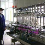 Máquina de enchimento líquida da garrafa giratória automática com tampando